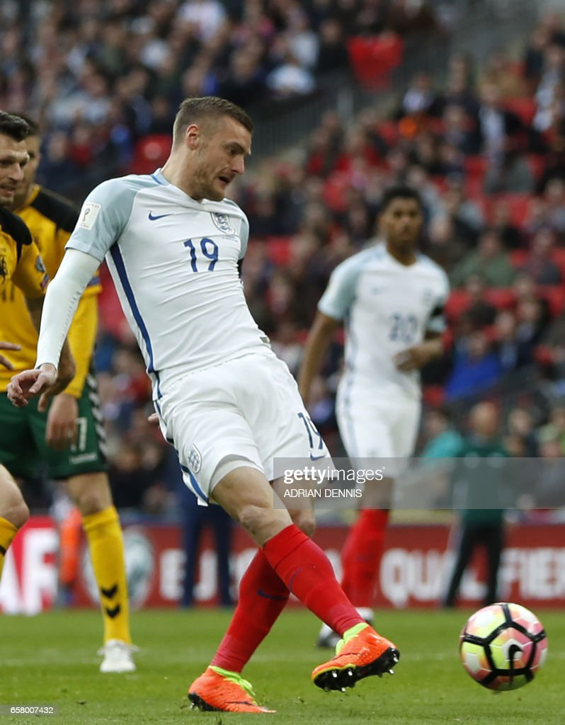 England's striker Jamie Vardy shoots to score their second goal during the World Cup 2018 qualification football match between England and Lithuania at Wembley Stadium in London on March 26, 2017. / AFP PHOTO / Adrian DENNIS / NOT