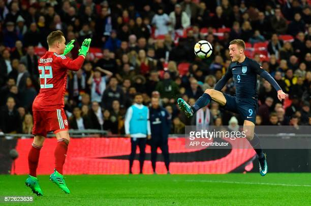 England's striker Jamie Vardy tries to control a ball and put it past Germany's goalkeeper MarcAndre ter Stegen but the ball spins wide during the...