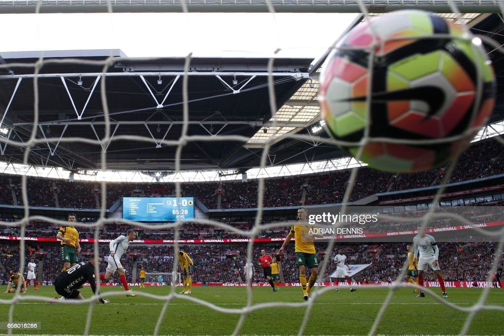 England's striker Jamie Vardy (centre left) turns to celebrate his goal as the ball strikes the back of the net during the World Cup 2018 qualification football match between England and Lithuania at Wembley Stadium in London on March 26, 2017. England won the game 2-0. / AFP PHOTO / Adrian DENNIS / NOT