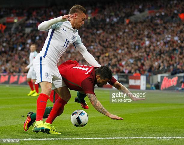 England's striker Jamie Vardy vies with Portugal's Vieirinha during the friendly football match between England and Portugal at Wembley stadium in...