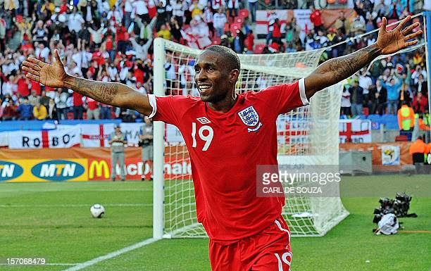 England's striker Jermain Defoe celebrates after scoring the opening goal during the Group C first round 2010 World Cup football match Slovenia vs...