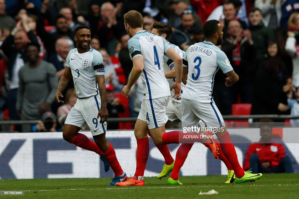 England's striker Jermain Defoe (L) celebrates with teammates after scoring his team's first goal during the World Cup 2018 qualification football match between England and Lithuania at Wembley Stadium in London on March 26, 2017. / AFP PHOTO / Adrian DENNIS / NOT