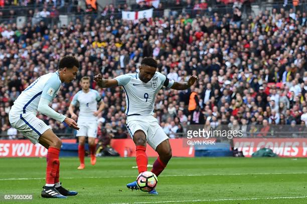 England's striker Jermain Defoe shoots to score his team's first goal during the World Cup 2018 qualification football match between England and...