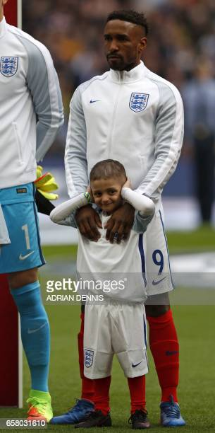 England's striker Jermain Defoe stands with Bradley Lowery a fiveyearold suffering from terminal cancer mascot for the match ahead of the World Cup...