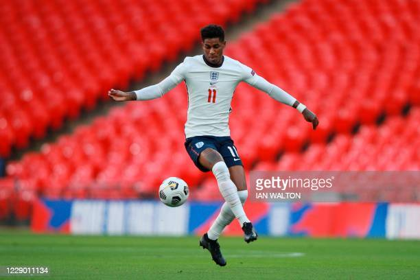 England's striker Marcus Rashford controls the ball during the UEFA Nations League group A2 football match between England and Belgium at Wembley...