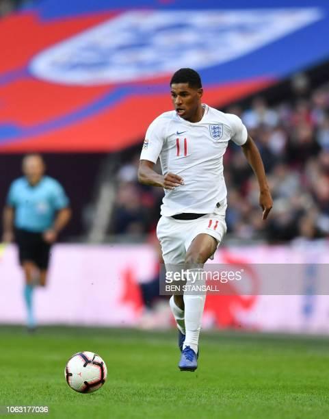 England's striker Marcus Rashford runs with the ball during the international UEFA Nations League football match between England and Croatia at...