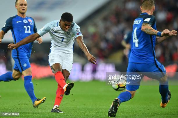 England's striker Marcus Rashford shoots to score England's second goal during the World Cup 2018 qualification football match between England and...