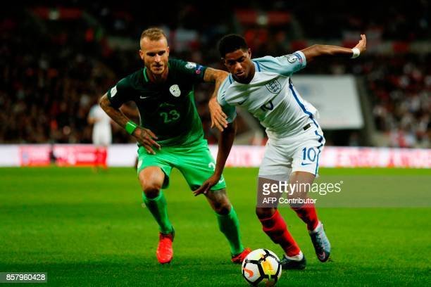 England's striker Marcus Rashford takes on Slovenia's defender Aljaz Struna during the FIFA World Cup 2018 qualification football match between...