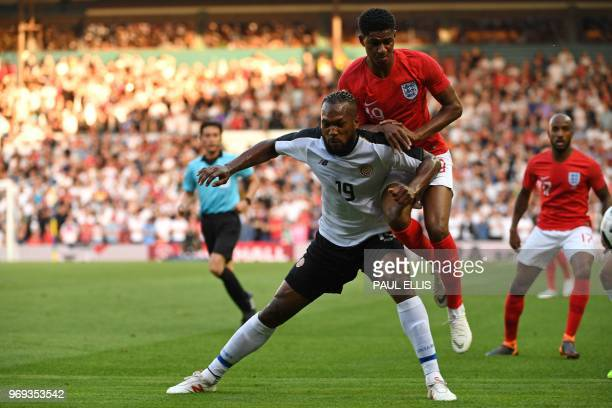 England's striker Marcus Rashford vies with Costa Rica's defender Kendall Waston during the International friendly football match between England and...