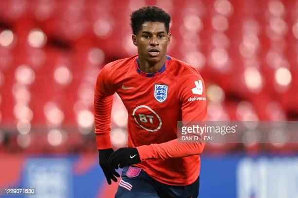 England's striker Marcus Rashford warms up before the UEFA Nations League group A2 football match between England and Denmark at Wembley stadium in...