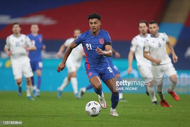 England's striker Ollie Watkins runs with the ball during the FIFA World Cup Qatar 2022 qualification football match between England and San Marino...