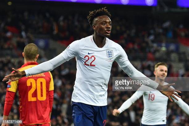England's striker Tammy Abraham celebrates after scoring their seventh goal during the UEFA Euro 2020 qualifying first round Group A football match...