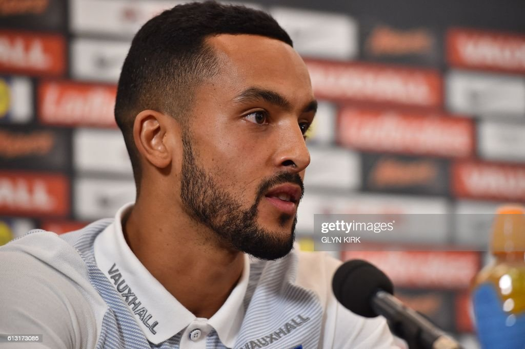 England's striker Theo Walcott answers a question during a press conference at Sopwell House hotel, north of London on October 7, 2016, ahead of England's 2018 World Cup qualifying football match against Malta on October 8. England will hope to erase the lingering stain of Sam Allardyce's embarrassing exit when interim manager Gareth Southgate takes charge for the first time in Saturday's World Cup qualifier against Malta. / AFP / Glyn KIRK / NOT