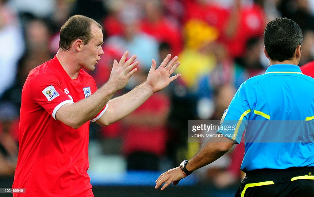 England's striker Wayne Rooney (L) argues with referee Jorge Larrionda from Uruguay during the 2010 World Cup round of 16 match Germany vs England on June 27, 2010 at the Free State stadium in Mangaung/Bloemfontein. Germany won 4-1. NO