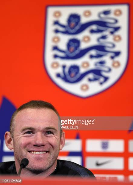 England's striker Wayne Rooney attends a press conference during a media day at St George's Park in Burton-on-Trent, central England on November 13...