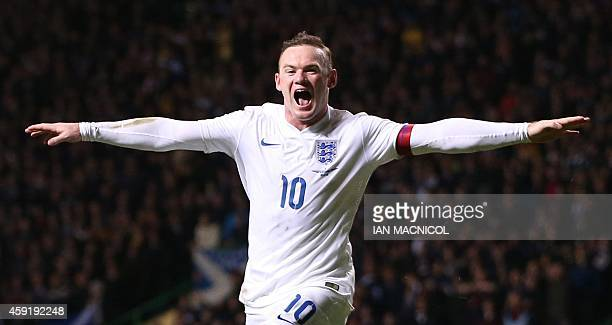 England's striker Wayne Rooney celebrates scoring their third goal during the international friendly football match between Scotland and England at...