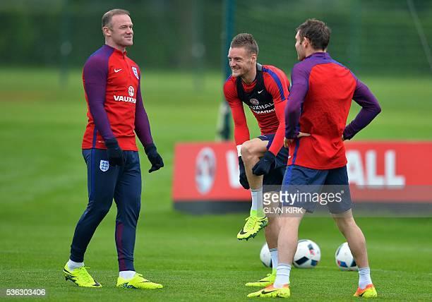 England's striker Wayne Rooney England's striker Jamie Vardy and England's midfielder James Milner react as they warm up during a team training...