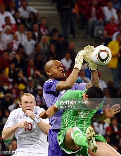 England's striker Wayne Rooney reacts as Algeria's goalkeeper M'bolhi Rais Ouheb catches the ball following an attempt by England to score during the...