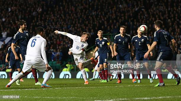 England's striker Wayne Rooney scores their second goal during the international friendly football match between Scotland and England at Celtic Park...