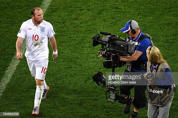 England's striker Wayne Rooney talks to a cameraman at the end of the Group C first round 2010 World Cup football match England vs Algeria on June 18...