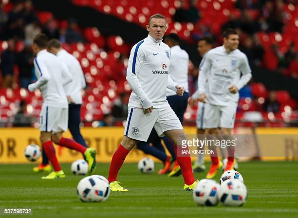 England's striker Wayne Rooney warms up before the friendly football match between England and Portugal at Wembley stadium in London on June 2 2016 /...