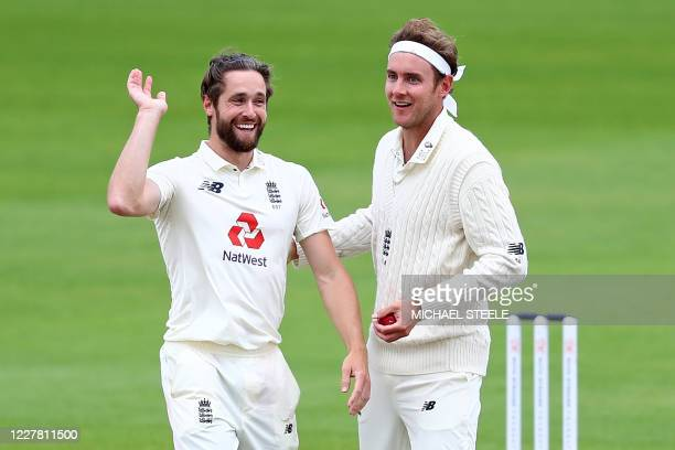 England's Stuart Broad and England's Chris Woakes celebrate taking the wicket of West Indies' Shai Hope on the final day of the third Test cricket...