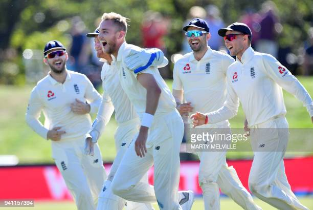 England's Stuart Broad and keeper Jonny Bairstow celebrate New Zealand's captain Kane Williamson being caught with team mates during day five of the...