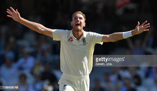 England's Stuart Broad celebrates after taking the wicket of Australia's Steve Smith during play on the fourth day of the fifth Ashes cricket Test...
