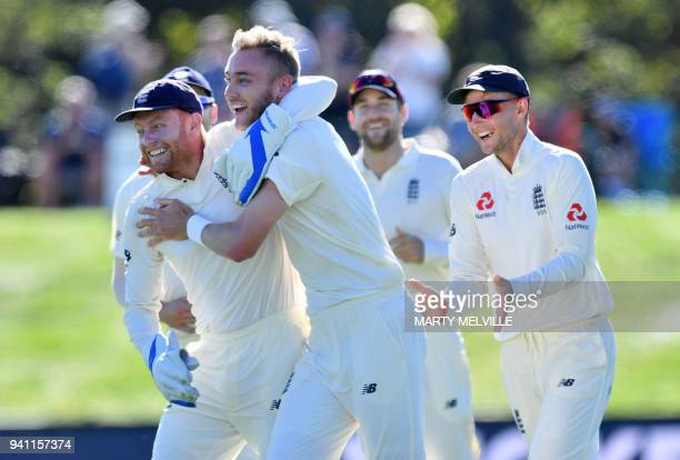 England's Stuart Broad celebrates New Zealand's captain Kane Williamson being caught with teammate keeper Jonny Bairstow during day five of the...