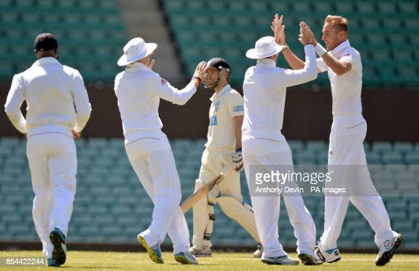 England's Stuart Broad celebrates taking the wicket of CA Invitational XI's Ryan Carters with the first ball of the day during an international match...