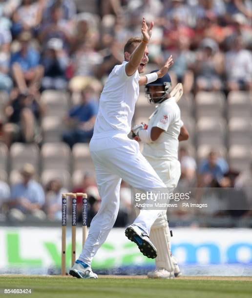 England's Stuart Broad celebrates taking the wicket of Cheteshwar Pujara during day three of the Third Investec Test match at the Ageas Bowl...