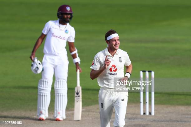England's Stuart Broad celebrates taking the wicket of West Indies' Kemar Roach on the third day of the third Test cricket match between England and...