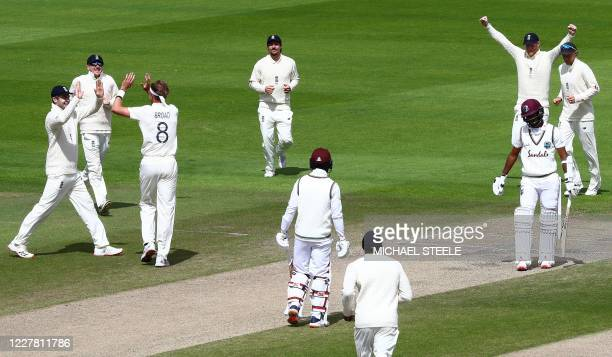 England's Stuart Broad celebrates taking the wicket of West Indies' Kraigg Brathwaite , his 500th Test wicket, on the final day of the third Test...