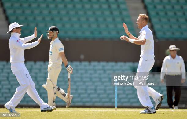 England's Stuart Broad celebrates with Graeme Swann after taking the wicket of CA Invitational XI's Ryan Carters with the first ball of the day...