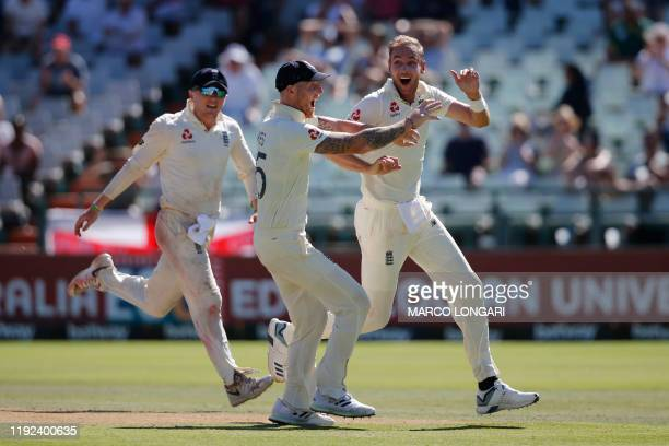 England's Stuart Broad celebrates with teammates after the dismissal of South Africa's Rassie van der Dussen during the fifth day of the second Test...