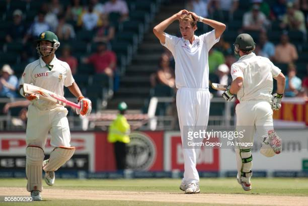 England's Stuart Broad holds his head as South Africa's JP Duminy and AB deVilliers score runs during the fourth Test at Wanderers Stadium...