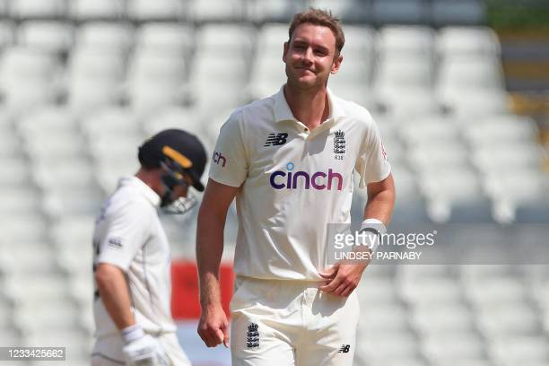 England's Stuart Broad smiles while bowling on the fourth day of the second Test cricket match between England and New Zealand at Edgbaston Cricket...