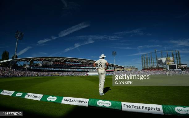 England's Stuart Broad stands in the outfield during play on the second day of the fifth Ashes cricket Test match between England and Australia at...
