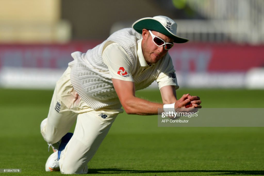 England's Stuart Broad takes the catch of South Africa's Keshav Maharaj on the third day of the second Test match between England and South Africa at Trent Bridge cricket ground in Nottingham, central England on July 16, 2017. / AFP PHOTO / Anthony Devlin / RESTRICTED
