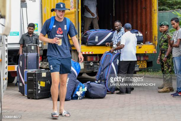 England's Stuart Broad walks to the bus after the Test series against Sri Lanka was postponed at the P Sara Oval Cricket Stadium in Colombo on March...