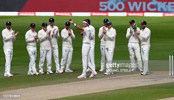 England's Stuart Broad waves as he celebrates taking the wicket of West Indies' Kraigg Brathwaite, his 500th Test wicket, on the final day of the...