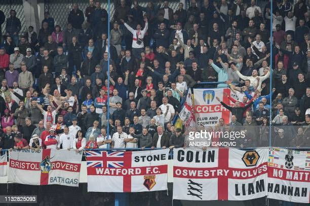England's supporters celebrate at the end of the Euro 2020 football qualification match between Montenegro and England at Podgorica City Stadium on...