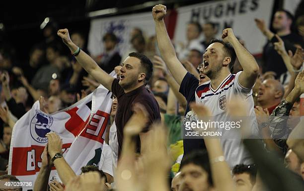 England's supporters gesture and shout during the friendly football match Spain vs England at the Jose Rico Perez stadium in Alicante on November 13...
