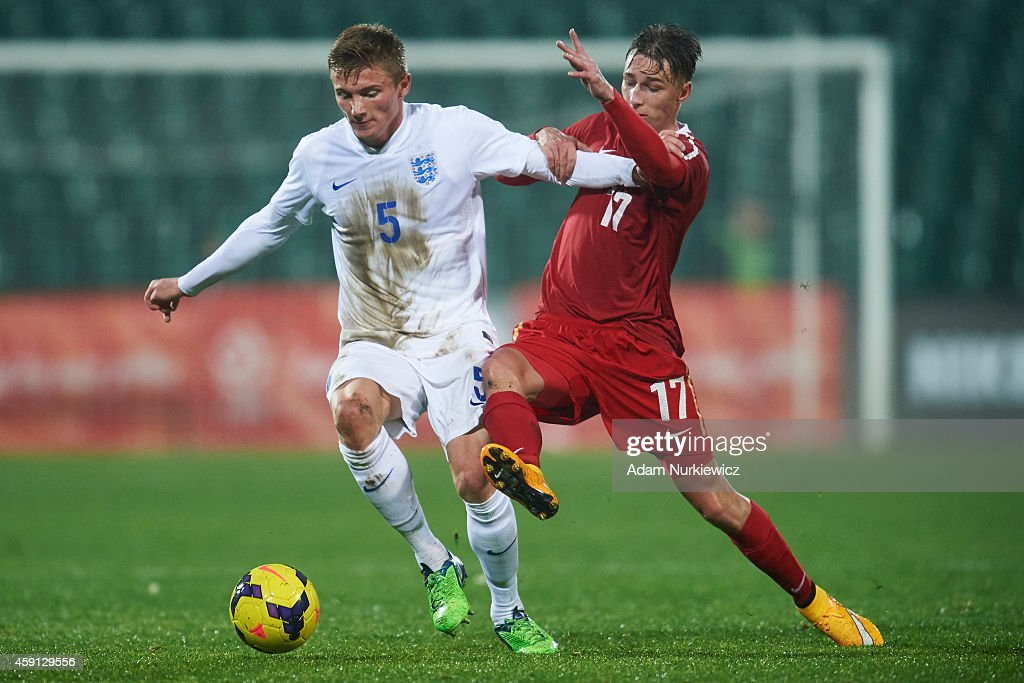 England's Taylor Moore (L) fights for the ball with Poland's Oktawian Skrzecz (R) during the international friendly match Under-18 between Poland and England at the MOSiR Stadium on November 17, 2014 in Gdansk, Poland.