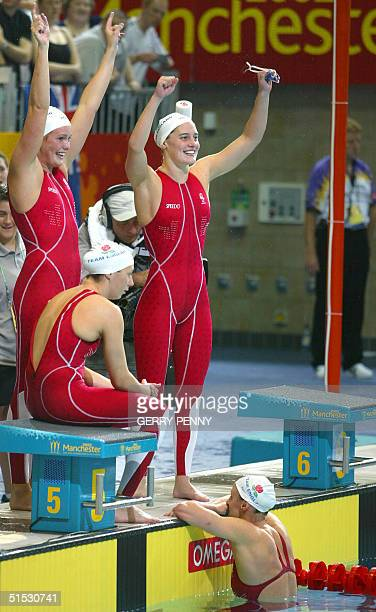 England's team celebrates after winning the 2002 Manchester Commonwealth Games women's 4x200m freestyle finals 01 August 2002 Karren Legg Georgina...