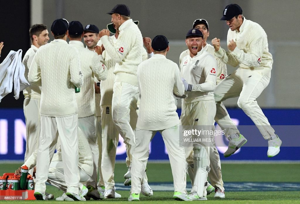 England's team celebrates dismissing Australia's batsman Steve Smith on the third day of the second Ashes cricket Test match in Adelaide in December 4, 2017. / AFP PHOTO / William WEST / -- IMAGE