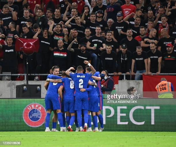England's team celebrates scoring during the FIFA World Cup Qatar 2022 qualification Group I football match between Hungary and England, at the...