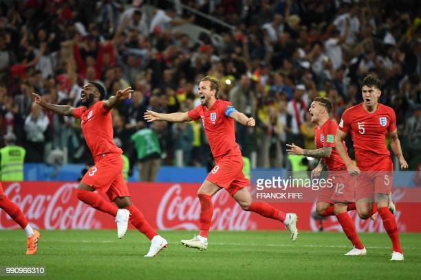 TOPSHOT England's team players celebrate after winning at the end of to the Russia 2018 World Cup round of 16 football match between Colombia and...