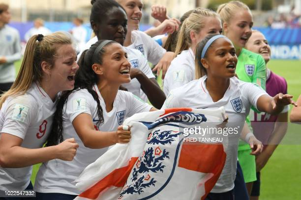 England's team players celebrate at the end of the Women's U20 World Cup 3rd place football match between France and England at the La Rabine stadium...