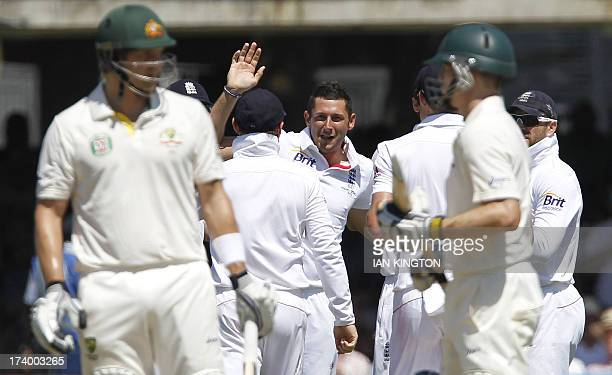 England's Tim Bresnan celebrates taking the wicket of Australia's Shane Watson for 30 runs during the second day of the second Ashes cricket test...